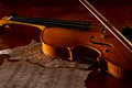Violin sheet and music on wooden floor with soft light Stock Images