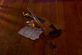 Violin sheet and music on wooden floor with soft light Royalty Free Stock Photography