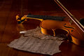 Violin sheet and music on wooden floor with soft light Royalty Free Stock Photo