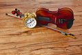 Violin time it is for music the bow and alarm clock are on a wood tabletop there is plenty of room for your copy Stock Images