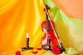 Violin viola with red roses on notes sheet Royalty Free Stock Photo