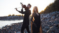 Violinist and girl,  young man plays on the Royalty Free Stock Photo
