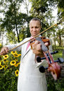 Violinist guy bridegroom play on violin in wedded day Royalty Free Stock Image