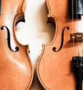 Violins detail of two on a white wall Royalty Free Stock Photo