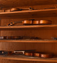 Violins on shelves Royalty Free Stock Photo