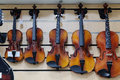 Violins in a shop Royalty Free Stock Photo