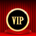 Vip mark icon in gold with jewels and the word on the podium on a background of red portieres Stock Images