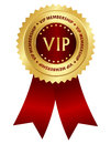 Vip membership award ribbon rosette gold and red with text inside isolated on white background Royalty Free Stock Photos