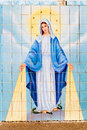 Virgin mary mosaic tile of the trampling a serpent at st s catholic church in marathon texas Stock Photos