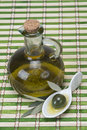 Virgin olive oil on a bamboo mat Stock Photos