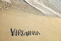 Virginia written on beach sand Stock Photo