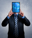 Virtual businessman entering the world through a digital tablet Royalty Free Stock Photography