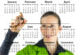 Virtual calendar with a woman writing in copyspace Royalty Free Stock Photo