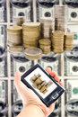 Virtual money in a handheld Royalty Free Stock Photo