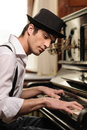 Virtuoso playing piano side view of handsome young man Stock Images