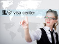 Visa center written on a virtual screen. Internet technologies in business and tourism. woman in business suit and tie Royalty Free Stock Photo