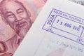 Visa passport stamp from vietnam and Vietnamese money (Dong) Royalty Free Stock Photo