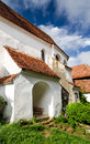 Viscri fortified church transylvania gate and stone wall of romania Royalty Free Stock Photo