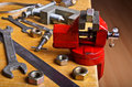 The vise to clamp on the desktop a wooden environment tools Royalty Free Stock Images