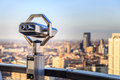 Vision binoculars overlooking city skyline concept for the future to what is important Stock Photo