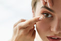 Vision Contact Lenses. Closeup With Beautiful Woman Face Royalty Free Stock Photo