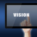 Vision female hand touch the word on tablet pc screen Stock Images