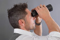 Vision perspective future man with binoculars Royalty Free Stock Photography