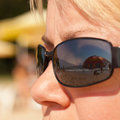 Vision of summer vacation beach scene reflected in woman sunglasses Stock Photography