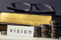 Vision word coins eyeglasses books Royalty Free Stock Photography
