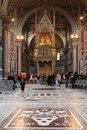 Visit of lateran basilica in rome unidentified tourists the san giovanni laterano roma italy on april the is the official Royalty Free Stock Image