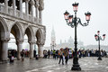 Visit to venice tourists in italy on a foggy day in the end of october at st marks square Stock Image