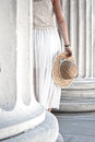 Visiting antiquities view of a woman holding a straw hat among ancient columns in greece Royalty Free Stock Image
