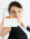 Visiting card businesswoman in suit hand holding blank calling female hand showing white in camera closeup partners contact Stock Photos