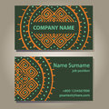 Visiting card template in dark green with ethnic s sign orange colors on grey gradient background shadows vector Stock Images