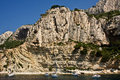 Visiting the cliffs of the mediterranean boaters visit Stock Images
