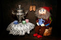 Visiting gnome composition with homemade elf and samovar Royalty Free Stock Photos