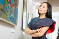 Visitor in the gallery young asian woman as a Royalty Free Stock Photo