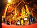Visitor praying inside of the famous mural painting of the northern THAILAND WAT PHUMIN Royalty Free Stock Photo