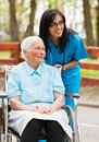 Visitors arriving elderly lady and nurse looking at the Royalty Free Stock Photos
