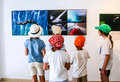 Visitors of the exhibition world press photo in arecife lanzarote arrecife spain aug children look at pictures spain primary Royalty Free Stock Photos
