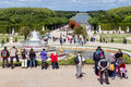 Visitors in garden Palace Versailles in Paris, France Royalty Free Stock Photo
