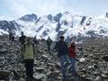 Visitors at laughton glacier climbing down from atop the near skagway alaska Stock Photo