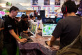 Visitors Playing Video Games at Indo Game Show 2013 Royalty Free Stock Photo