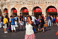 Visitors spectators are taking verona italy august waiting outside the arena di verona for entrance in the opera late afternoon on Stock Photo