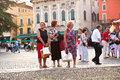 Visitors spectators are waiting verona italy august outside the arena di verona for entrance in the opera late afternoon on august Royalty Free Stock Photography