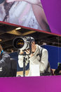 Visitors test huge tele lenses photokina cologne september photokina world of imaging top event for the trade and user september Royalty Free Stock Photos