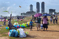 Visitors to galle face green in colombo sri lanka enjoy a sunny afternoon vicitors as toy seller tries entice customers Stock Photo