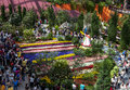 Visitors to the gardens by the bay in singapore admire the beautiful tulip display is a nature park spanning Stock Image