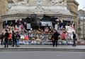Visitors traveling in the city standing in front of charlie hebdo memorial place de la republique paris moving tribute lives lost Stock Photography