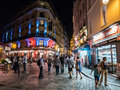 Visitors wander busy pedestrian street on an august evening in paris france a cobblestone the th arrondissement Stock Photos